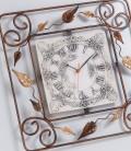 Orologio quadrato in ferro battuto decorato con foglie